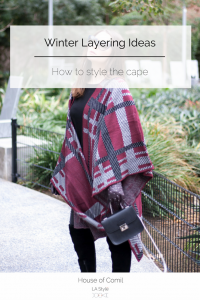 Winter layering ideas to be stylish and cozy when it's freezing! How to style the cape and the lace-up sweater on Houseofcomil.com. Click to read more or pin to save for later.