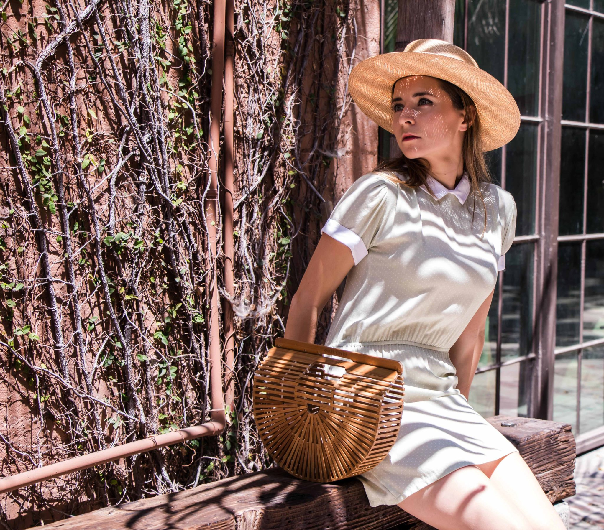 Cult Gaia Janessa Leone Christy Dawn - Best of summer bags: vintage inspiration. Best round rattan bag, straw bag, cult gaia bamboo bag, Jane Birkin basket bag, market bag, woven bag to upgrade your summer outfits.