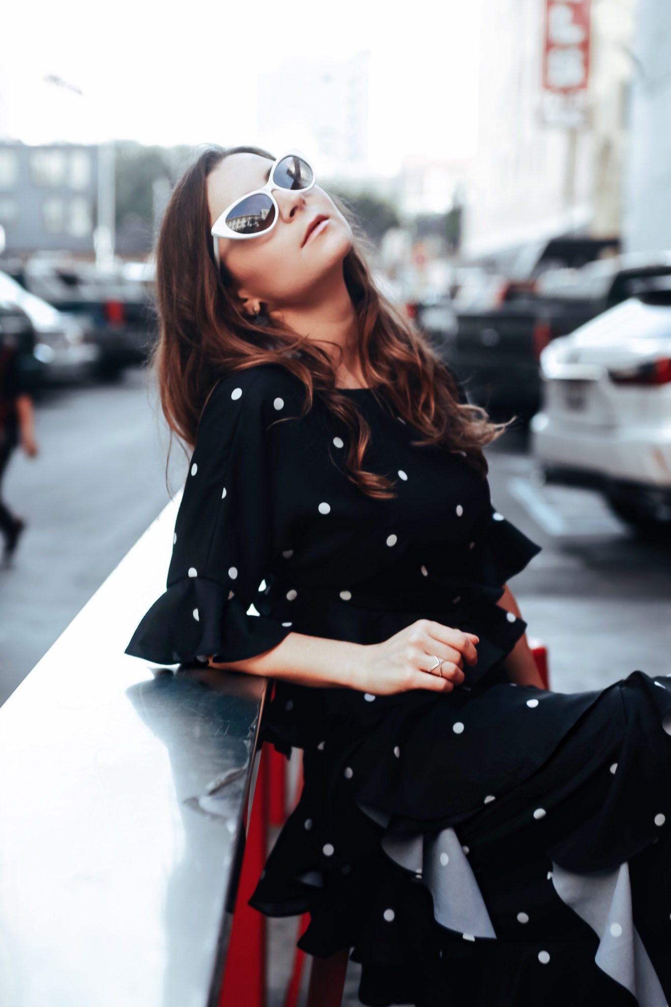 Evening dresses with Fame and Partners, A LA brand specialized in wedding party dresses. Julia Comil, French Fashion blogger in Los Angeles features the black and white polka dots Marisa dress from Fame and Partners - shot in Downtown Los Angeles