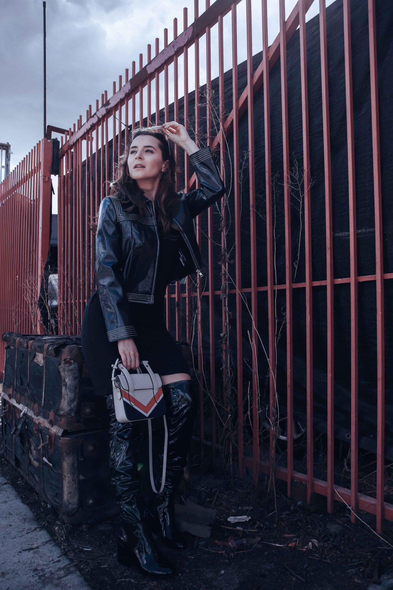 How to style Patent leather jacket and Patent leather boots - How to style the Vinyl trend. More on Houseofcomil.com - Blue Leather jacket by Ganni on If Chic, Nano MC Chevron Bag by Strathberry. Styled by Julia Comil French Fashion Blogger in Los Angeles