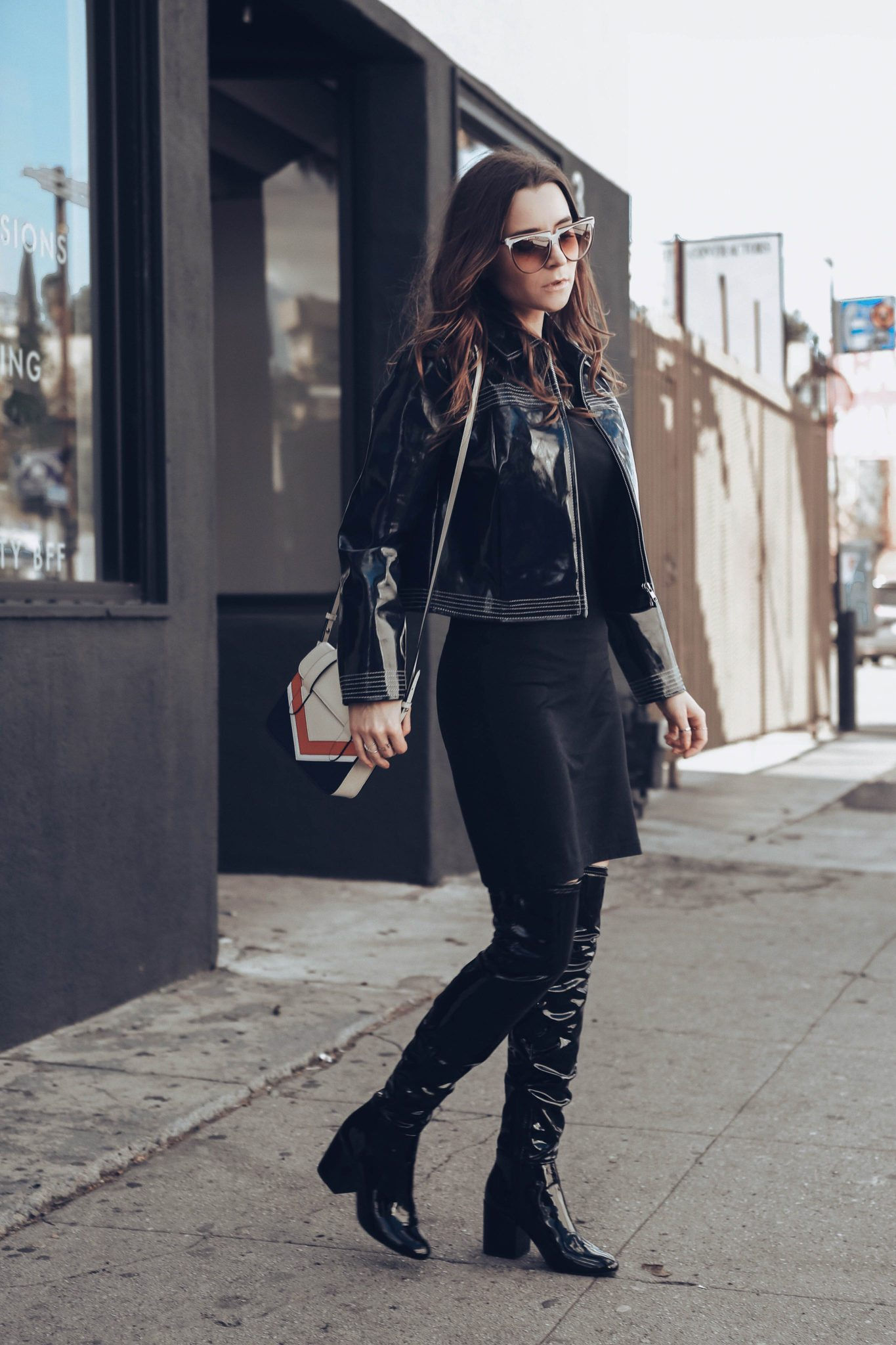 How to style Patent leather jacket and Patent leather boots - How to style the Vinyl trend. More on Houseofcomil.com - Blue Leather jacket by Ganni on If Chic, Nano MC Chevron Bag by Strathberry, Patent Leather Boots OTK by Aldo. Styled by Julia Comil French Fashion Blogger in Los Angeles