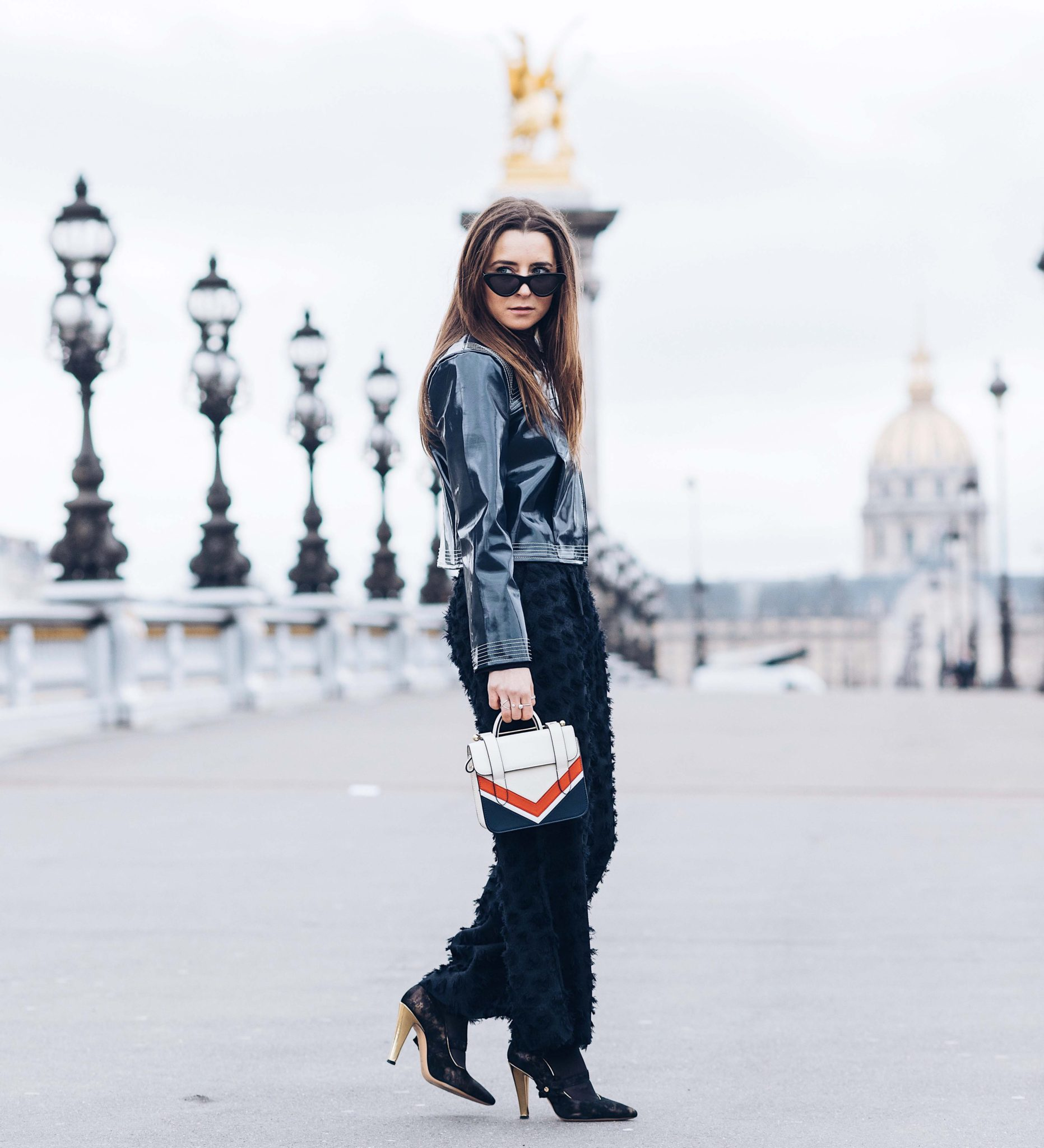 Best Street Style Paris Fashion Week Mars 2018 of Julia Comil / French Fashion Blogger in Los Angeles - Outfit for Chanel Fall Winter 2018 2019 show - Ganni Motor Jacket - Strathberry bag - Gold shoes Dimmino