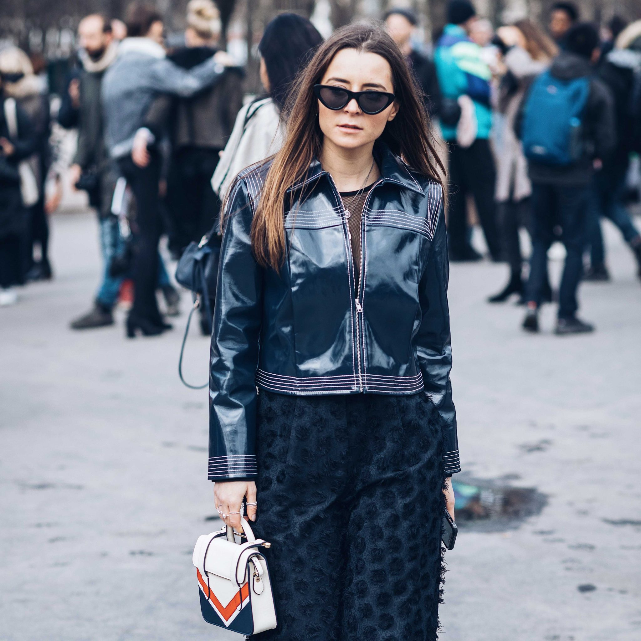 Best Street Style Paris Fashion Week Mars 2018 of Julia Comil / French Fashion Blogger in Los Angeles - Outfit for Chanel Fall Winter 2018 2019 show - Ganni Motor Jacket - Strathberry bag