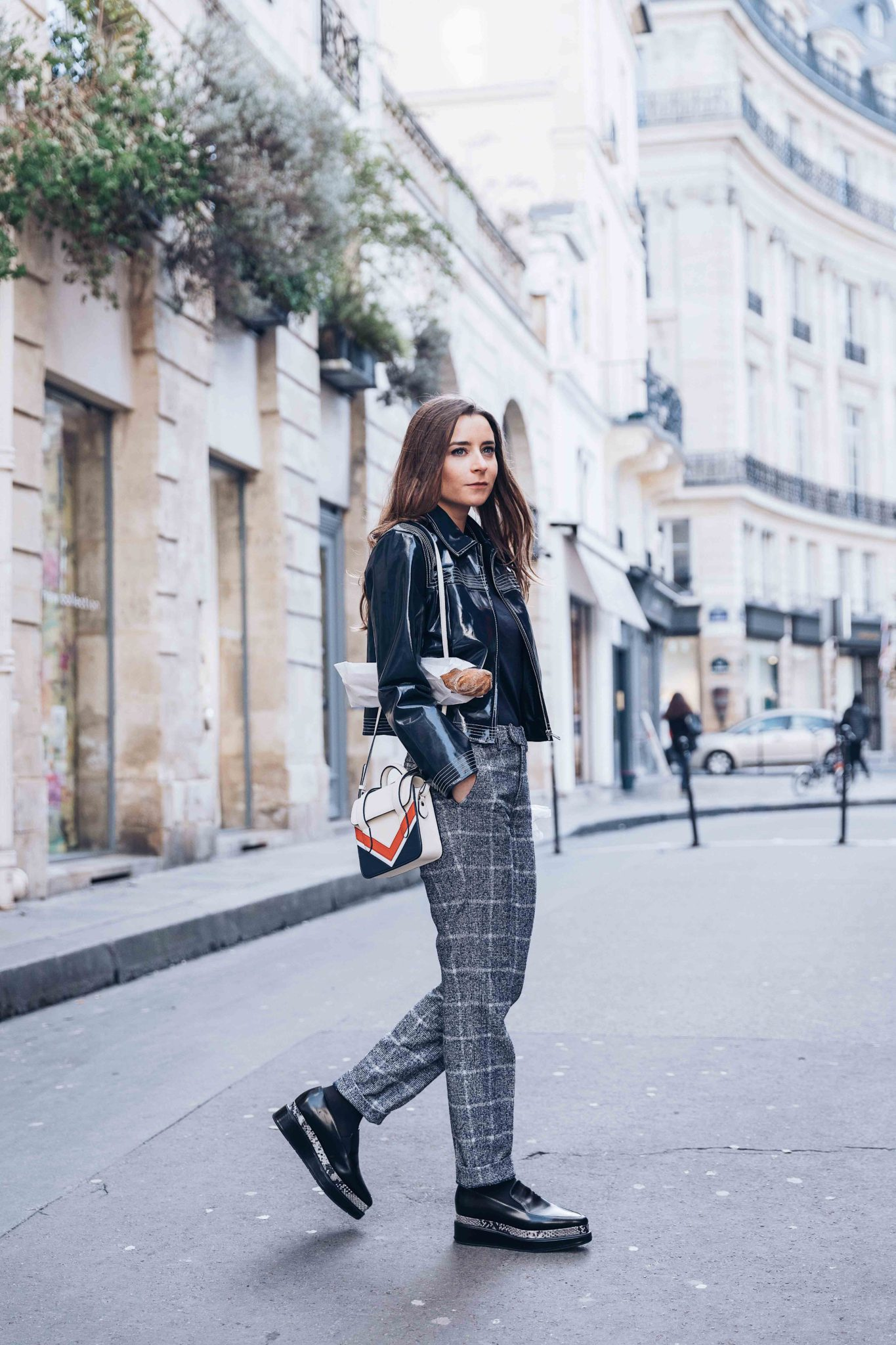 Parisian style by Julia Comil French Fashion Blogger Wearing Seven All Around Platform Loafers - Strathberry Bag - Suistudio check pants - Ganni Patent cropped jacket - Save to read more about Seven all around review on Houseofcomil.com