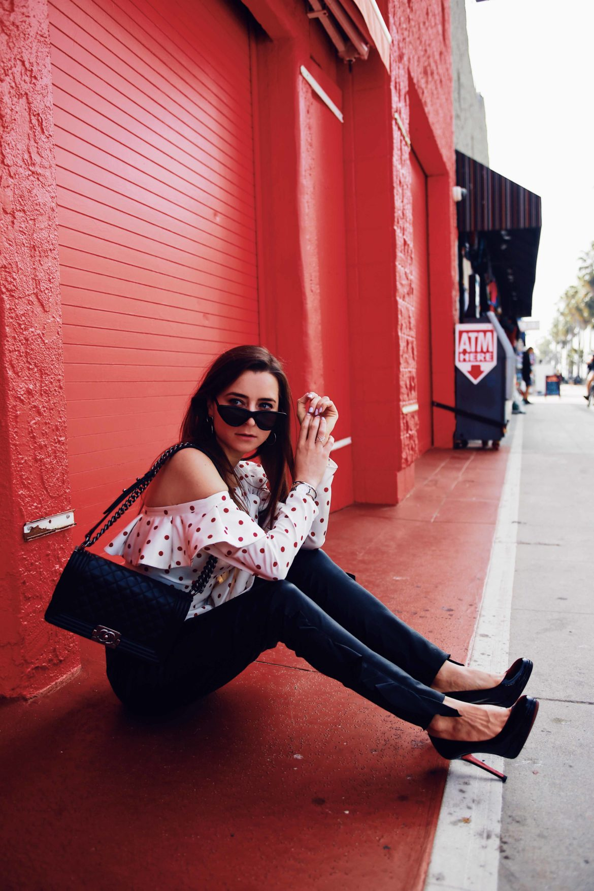 Best Style quotes to live by - Ruffled skinny leather pants by Iro and structured polka dots blouse by Self Portrait via If Chic - More about this sophisticated and edgy look on Houseofcomil.com. Pictures by Julia Comil French Fashion Blogger in Los Angeles