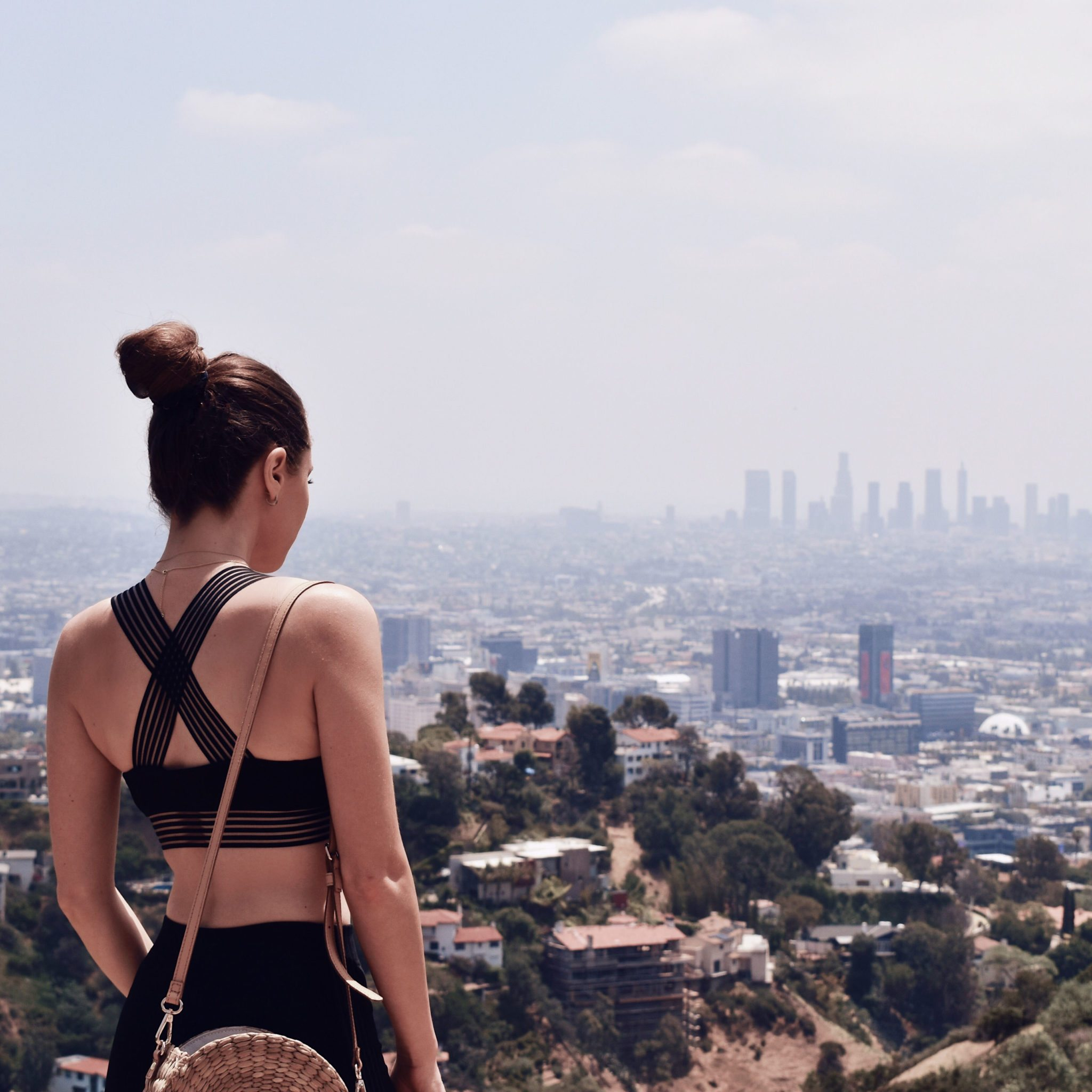 Fashion Diaries: Revolve Around The World Parties in Los Angeles - Lovewave sport bra and black leggings worn by Fashion Blogger Julia Comil. More on Houseofcomil.com. Pin to read it later. Location Runyon Canyon Los Angeles - Active wear outfit