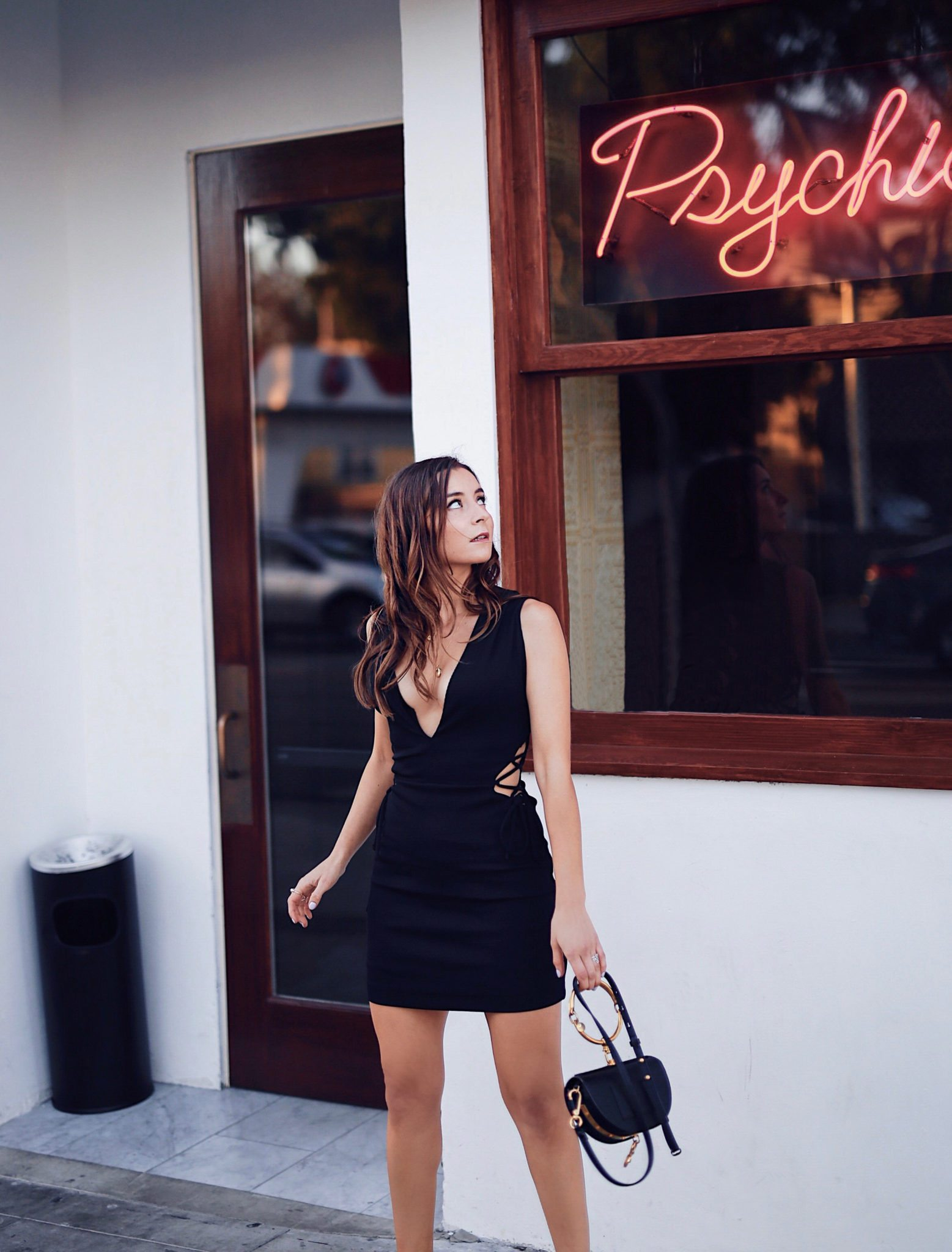 Fashion Diaries: Revolve Around The World Parties in Los Angeles - NBD Magnolia Lace up Mini Dress in Black worn by Fashion Blogger Julia Comil. More on Houseofcomil.com. Pin to read it later. Location Delilah club West Hollywood Los Angeles - Clubbing outfit