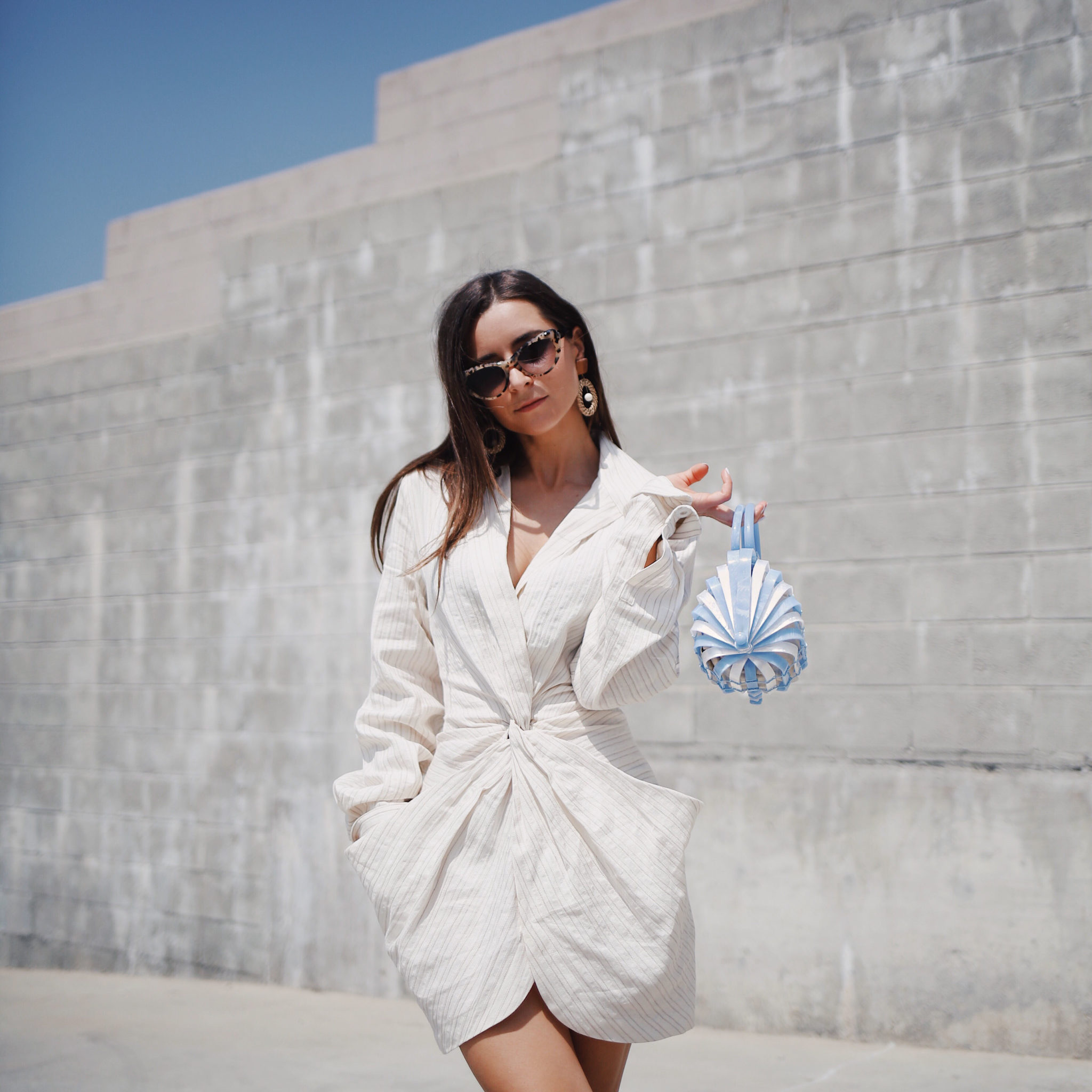 Discover Jacquemus the French Not So Parisian Designer on Houseofcomil.com. French Fashion Blogger Julia Comil is wearing a Jacquemus Dress, Bag Cult Gaia, and Krewe x Reformation sunglasses in Los Angeles