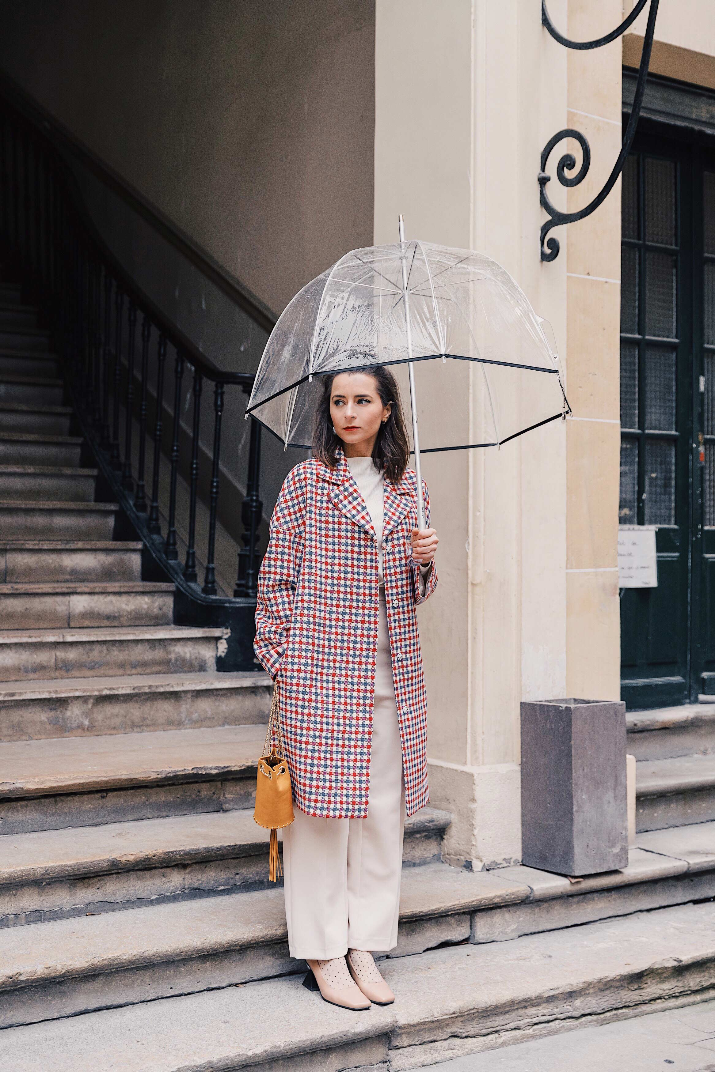 Issey Miyake Best Street Style Fashion Week Mars 2019 Julia Comil / French Fashion Blogger in Los Angeles Outfit for PFW Fall Winter 2019 show - red checked coat tara jarmon, pants tara jarmon, shoes Yuul Yie, Bag Delafon Paris
