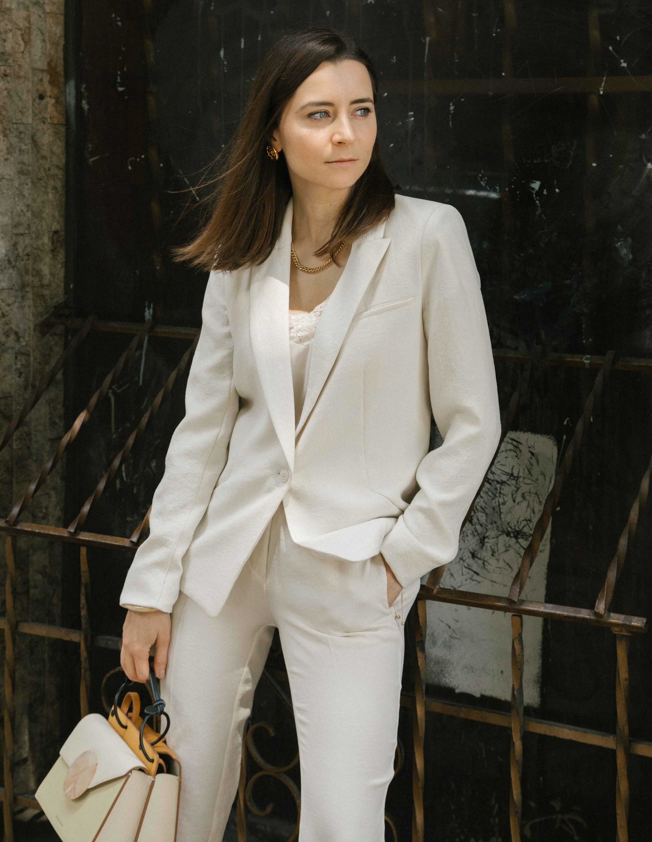 How to wear the white suit for women. White party outfit ideas and summer outfit ideas are on Modersvp.com. White suit from Ba&Sh Paris worn by Julia Comil Bracelet Lizzie Fortunato