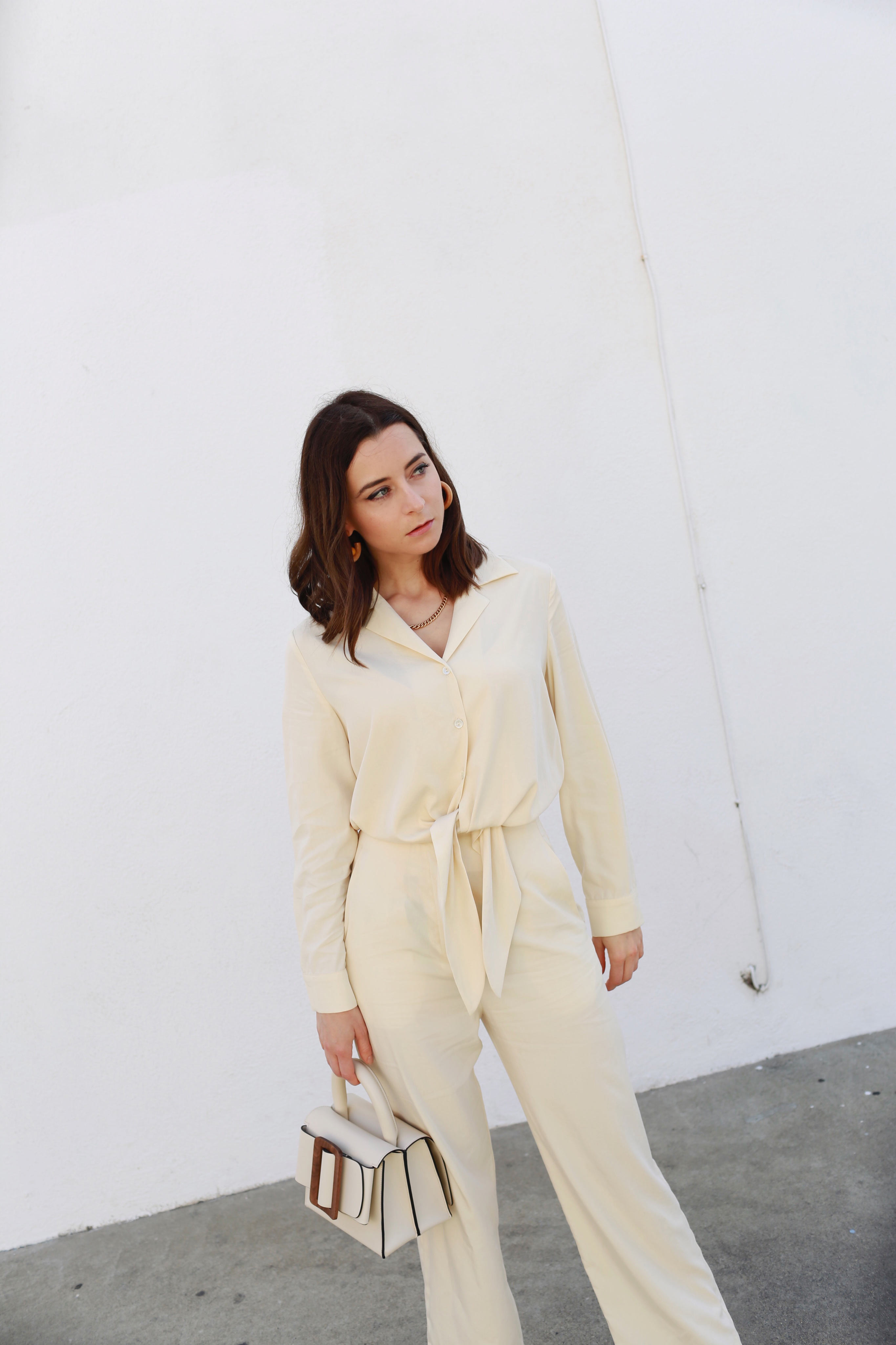 How to wear the white suit for women. White party outfit ideas and summer outfit ideas are on Modersvp.com. White suit from Ba&Sh Paris worn by Julia Comil vanilla jumpsuit via Nanushka