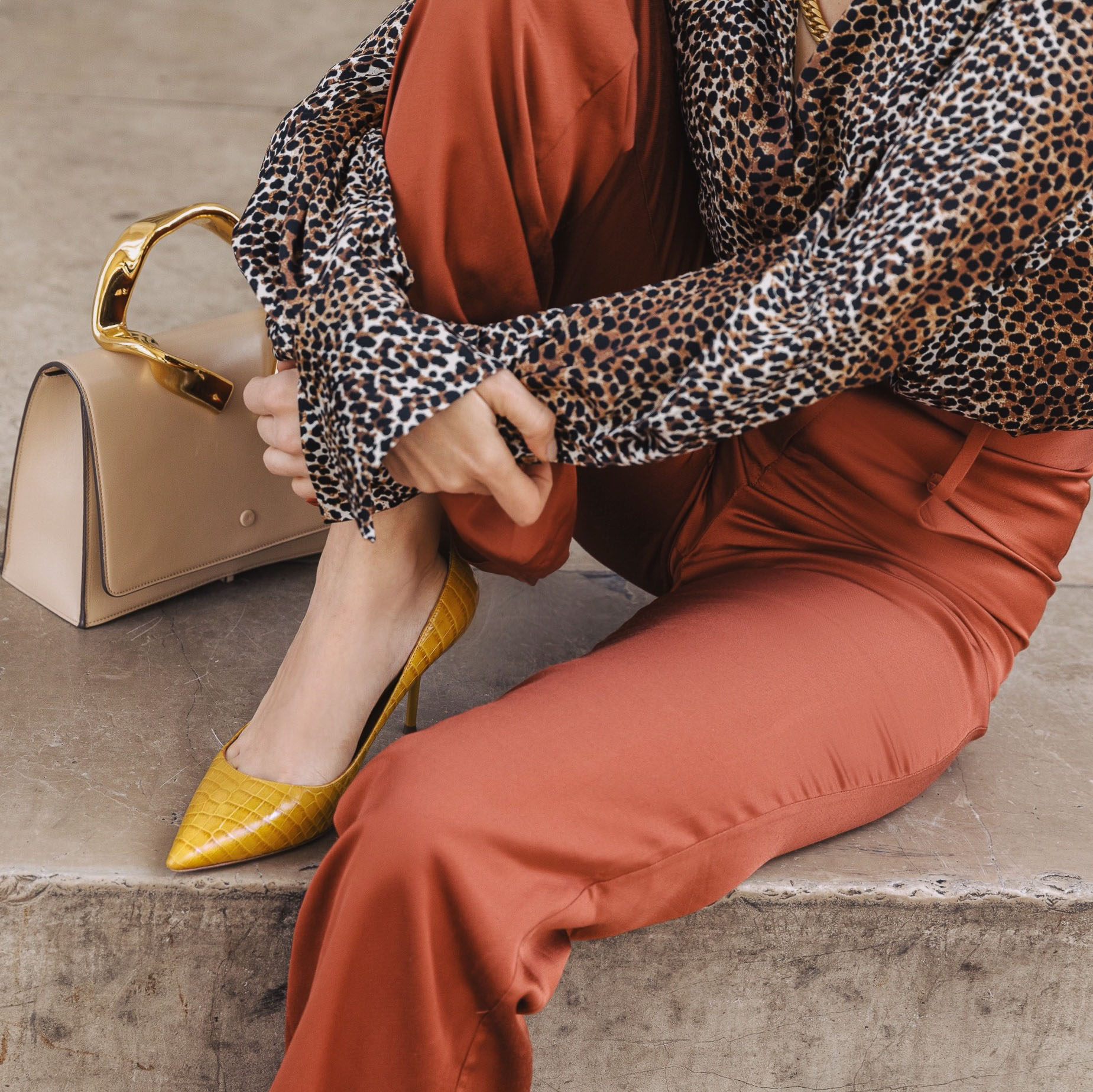 PFW SS20 Street Style Fall 2019 Paris Fashion Week Julia Comil wearing Madiyahalsharqi pants, bag L Etrange Paris, pumps Monnier Freres x Aquazurra, blouse Equipment