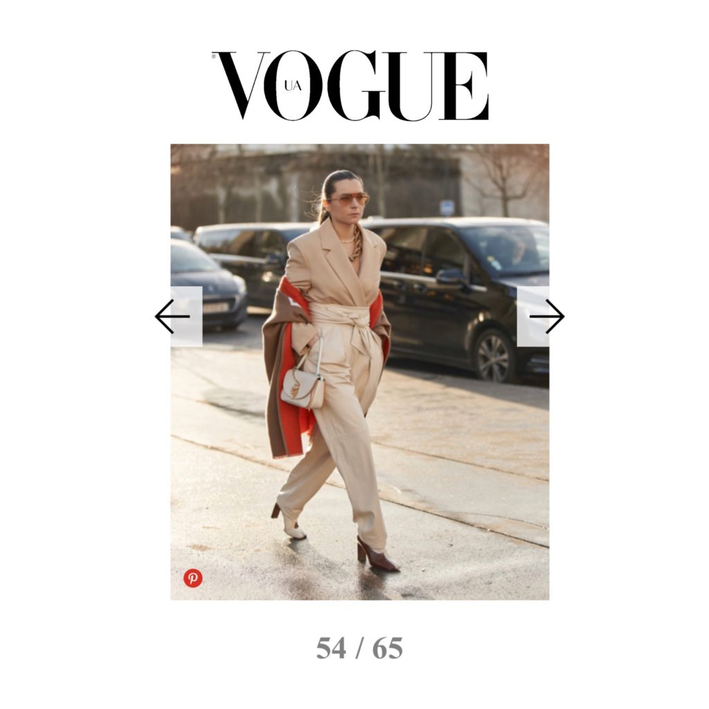 Vogue Ukraine - Best of Paris Fashion Week Street Style Fall 2020 - Julia Comil shot by The Style Stalker - Julia Comil is wearing wearing Kristina Fidelskaya jacket and pants, JW Anderson bag, Wandler pumps, Burberry cape, Ferragamo sunglasses, Brinker & Eliza necklace