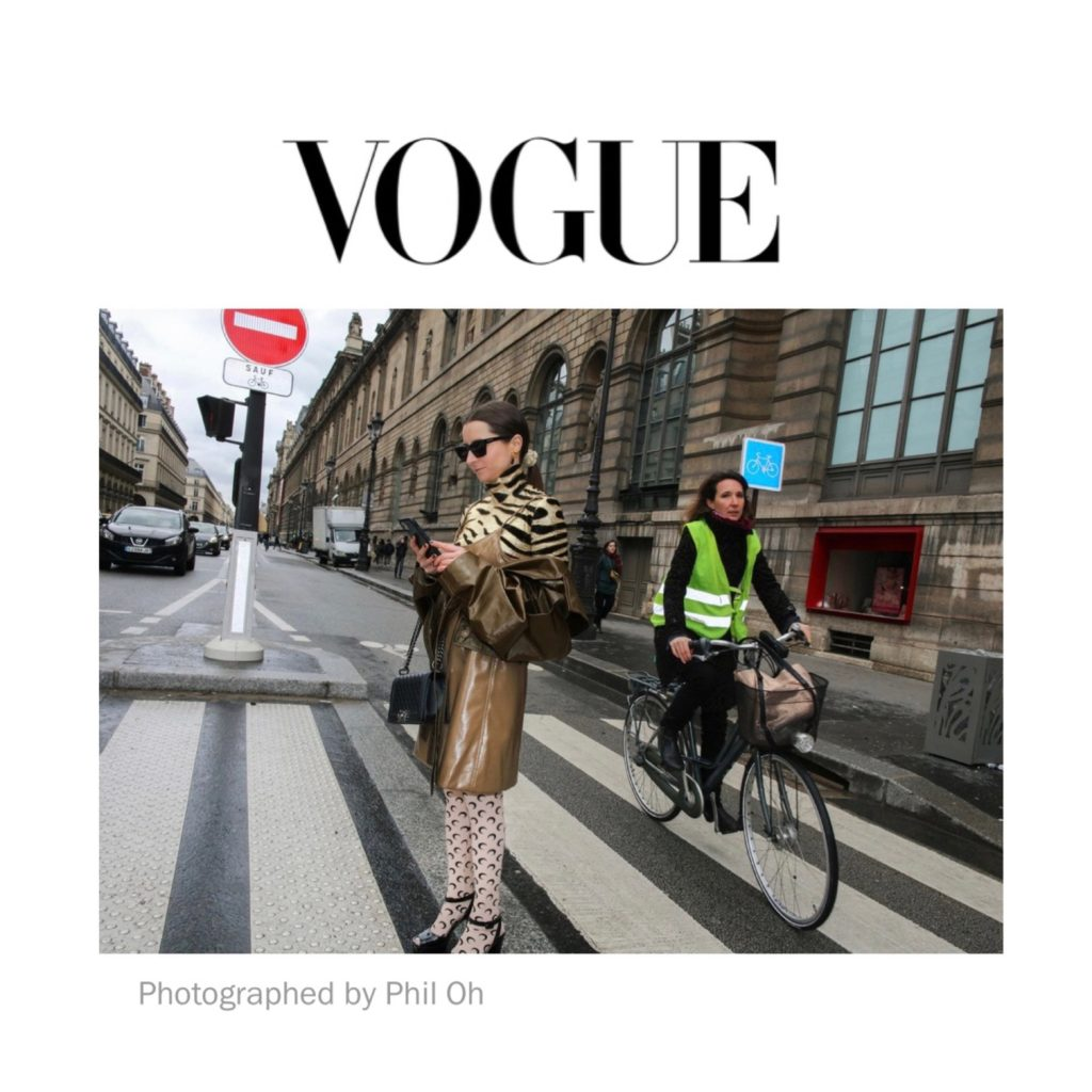 Vogue US - Best of Paris Fashion Week Street Style Fall 2020 - Julia Comil shot by Phil Oh. French influencer Julia Comil is wearing Kristina Fidelskaya jacket, Paco Rabanne top, Marine Serre tights, Ganni dress, Giuseppe Zanotti platform sandals