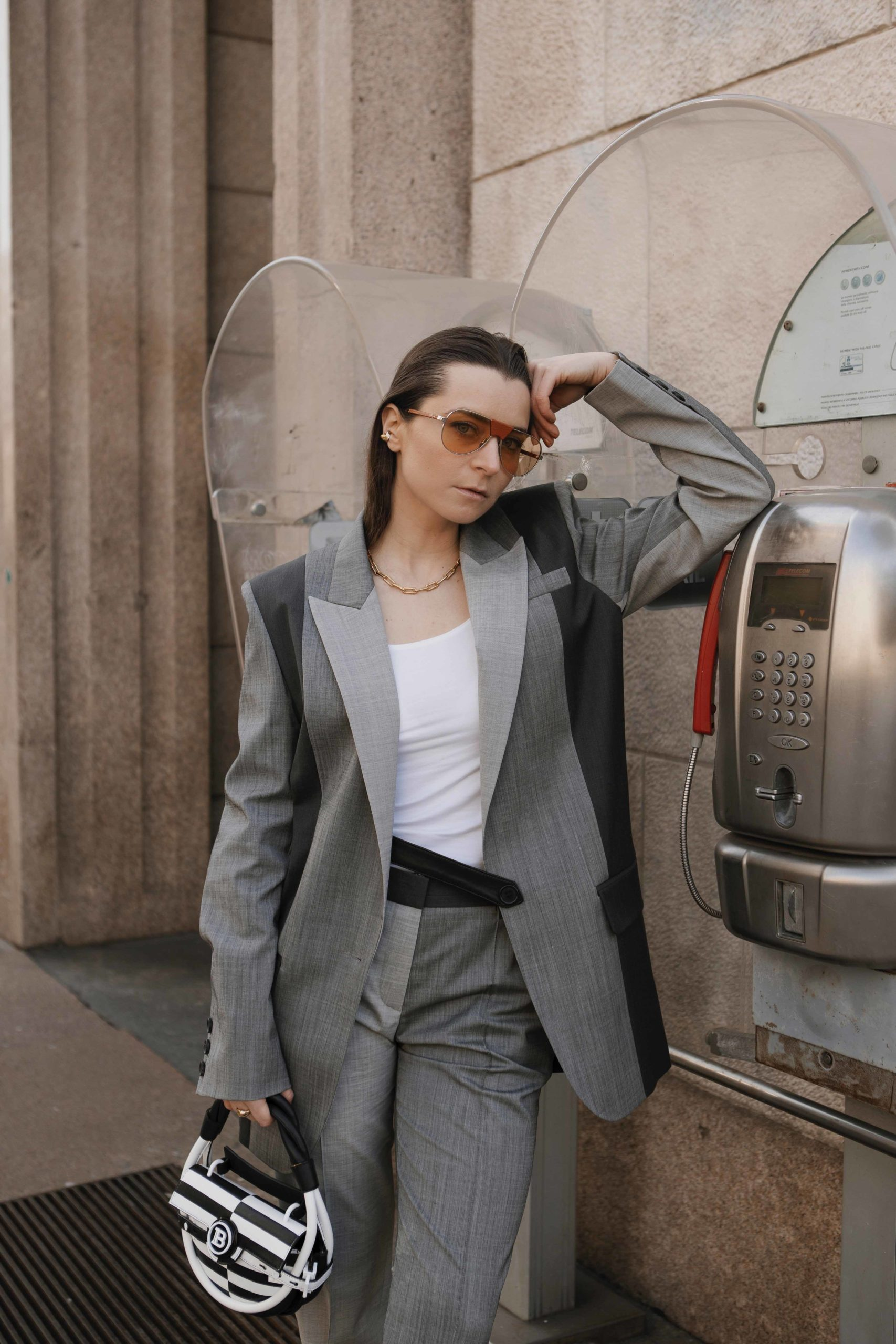 grey suit for women milan fashion week street style 2020 AW march 2020 julia comil balmain bag barbara bui bottega venetta sandals gucci socks