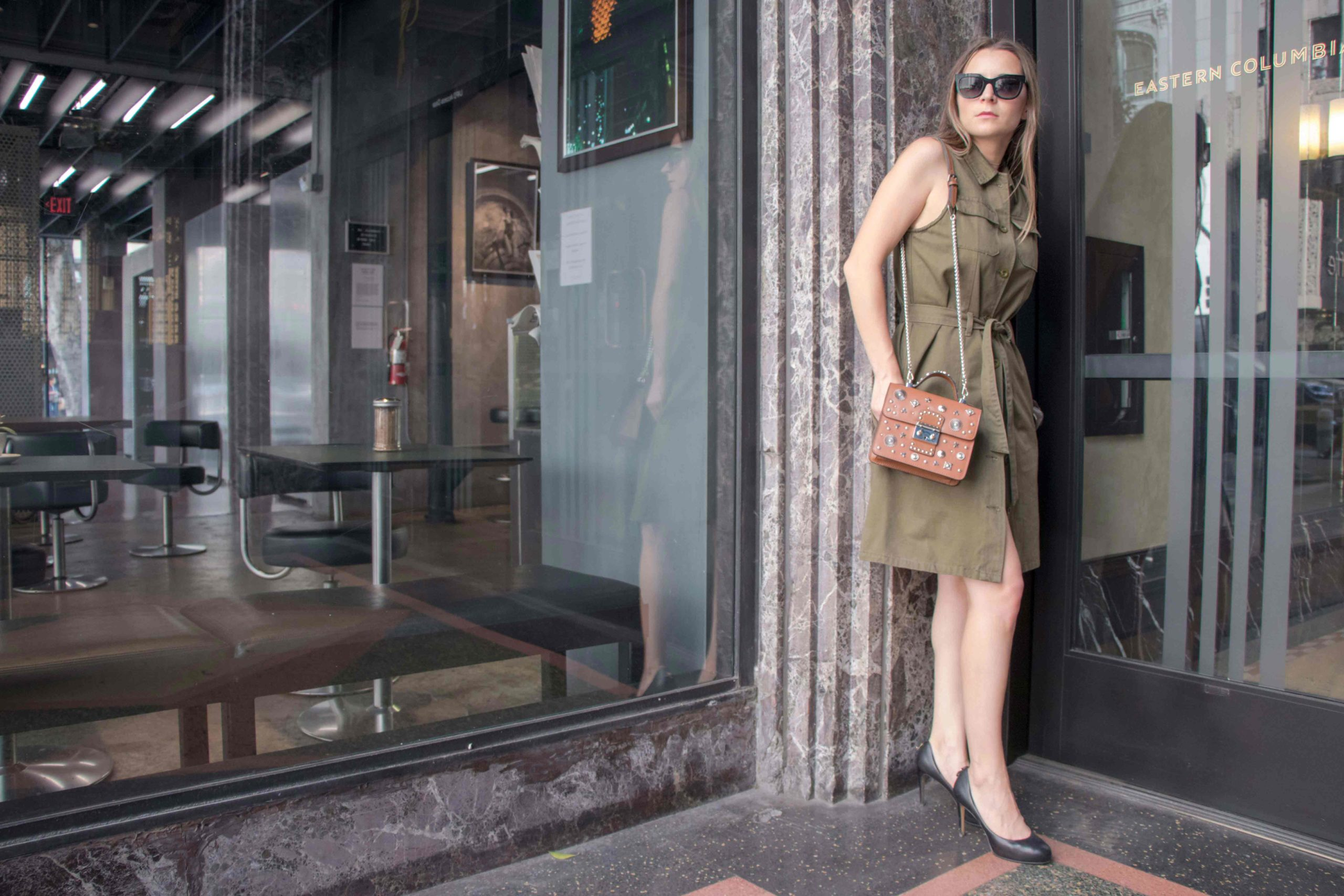 Fall dresses 2017: How to transition from summer to fall with the sleeveless shirt dress - Effortless chic dress from Zan Style and studded brown satchel bag from Lollo Vita. More on MODERSVP.com