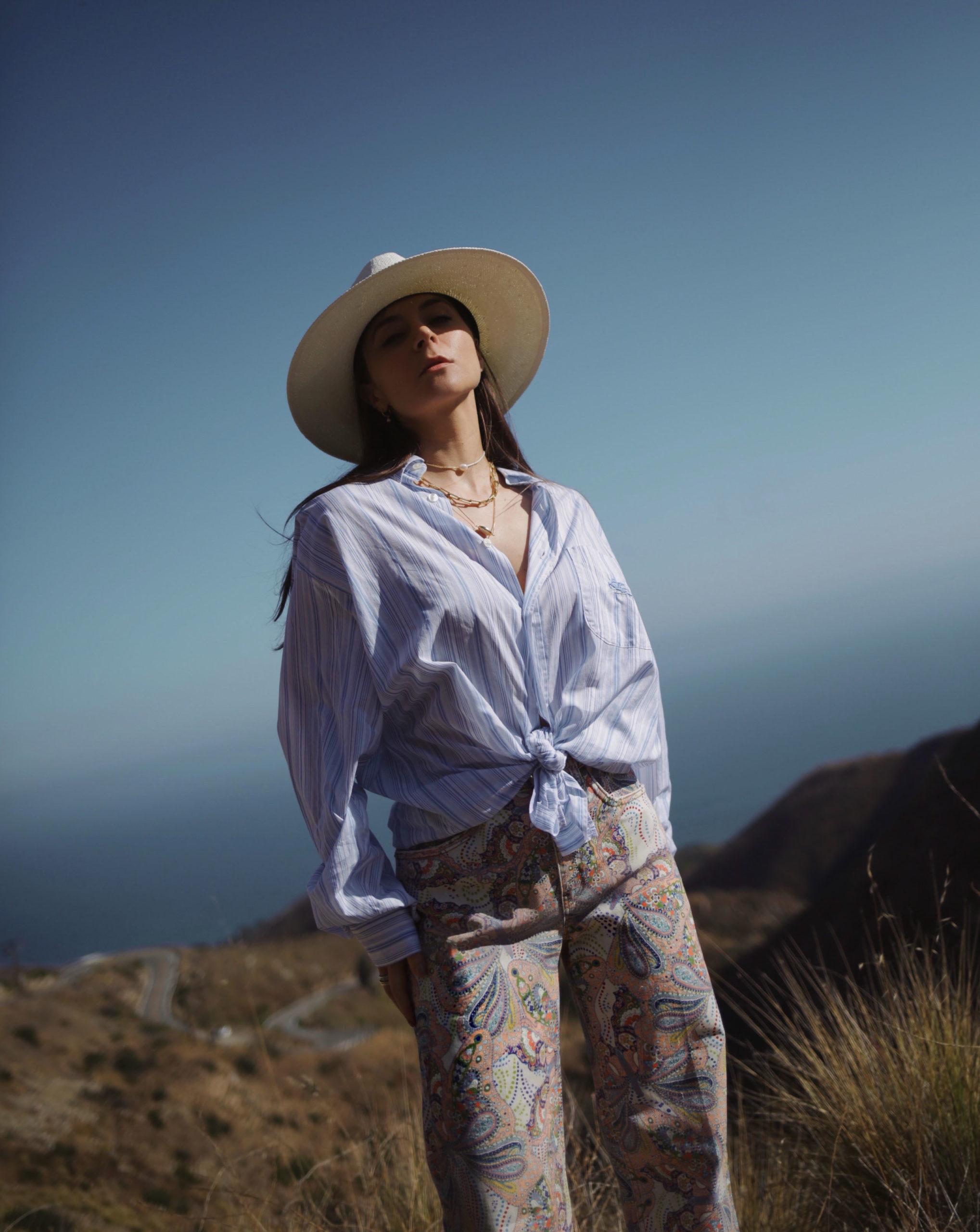 Summer style in Malibu etro fashion editorial 2020 - etro 70s denim boho chic outfit style summer style edgy chic cashmere denim pants