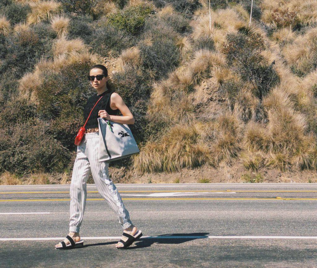 Longchamp-red-camera-bag-Longchamp-silk-striped-track-pants-Longchamp-cropped-top-spring-summer-2021---street-style-fall-winter-2021-to-attend-the-Longchamp-digital-show-julia-comil-shot-by-Edward-Berthelot-web
