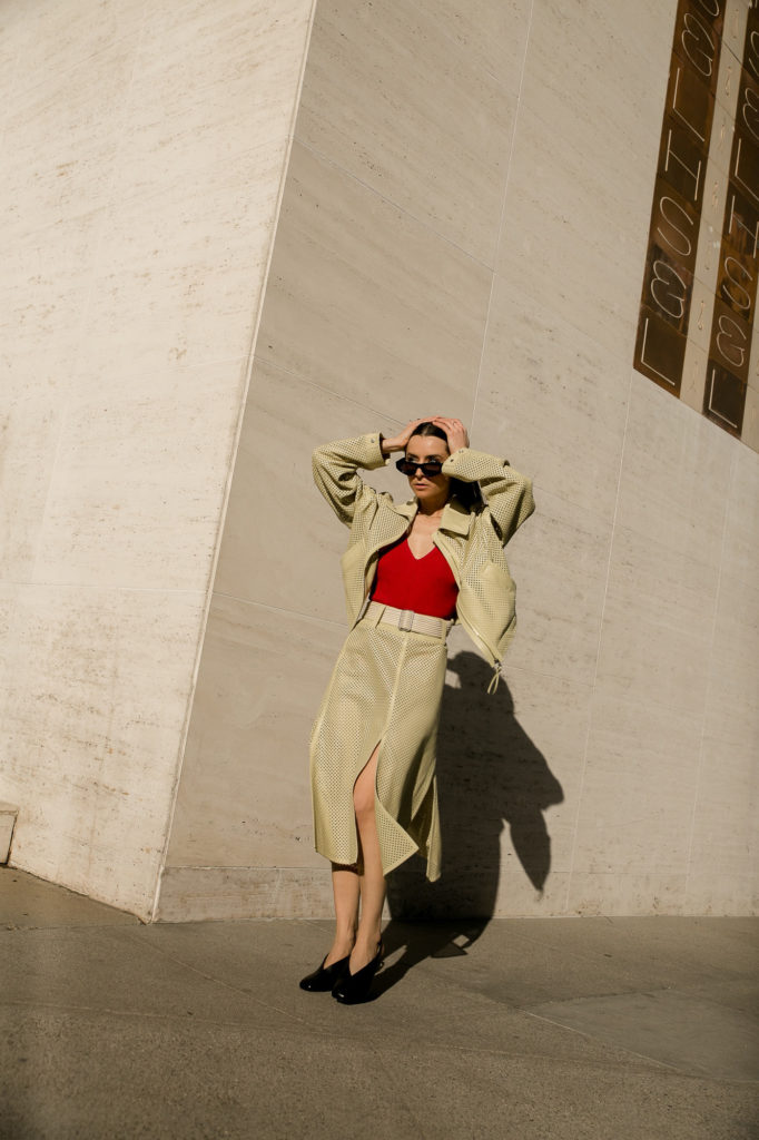 Salvatore ferragamo perforated leather jacket skirt in lime red bodysuit spring summer 2021 - street style fall winter 2021 julia comil attends the Ferragamo digital show shot by Mire Yang Pleatstudio
