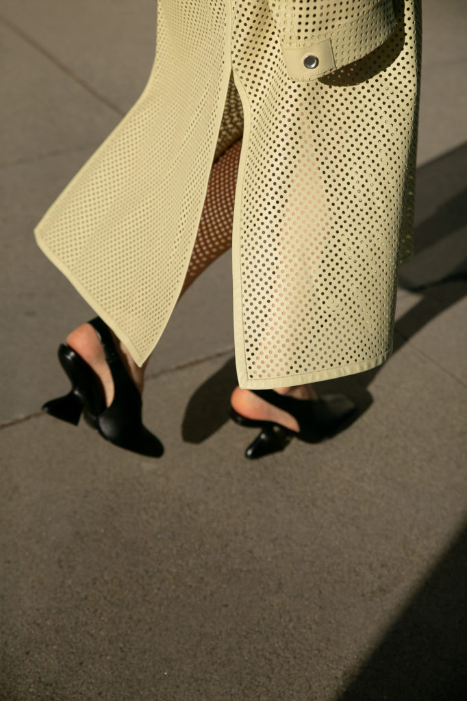 Salvatore ferragamo perforated leather jacket skirt in lime red bodysuit spring summer 2021 - street style fall winter 2021 to attend the Ferragamo digital show julia comil shot by Mire Yang Pleatstudio